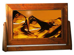 sand art frame in moving sand moving pictures