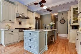 harbor breeze ceiling fan in kitchen traditional with crown molding baseboards baseboards ceiling fan