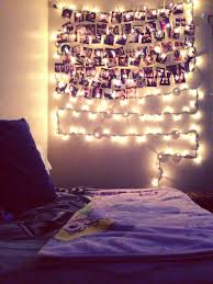 My wall in my room--Christmas lights, photographs, and clothespins.