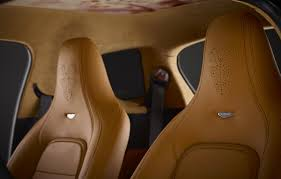 Q - custom in house interiors by Aston Martin, Floral painted leather  headliner and cygnet perforated headrests with custom stitching.