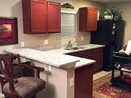 granite in kitchen with cherry cabinets countertops