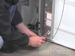 replacing cables on a torsion spring garage door
