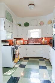 shabby chic kitchen with space savvy design and copper backsplash from kristie barnett