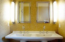 yellow penny tiles add golden glint to the small bathroom photography corynne pless