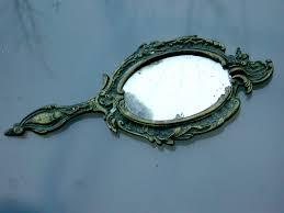hand holding antique mirror. Modren Mirror Antique Hand Mirror To Holding