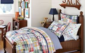 cute and colorful little boy bedroom ideas plaid and dark wood boys room blue accents