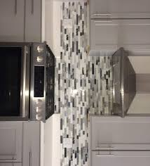 residential kitchen backsplash oceanside devotion mistique blend random linear glass mosaic gray painted cabinet white quartz modern