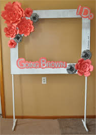 diy photo frame ideas with paper booth frame with paper flowers on a pvc pipe stand