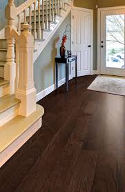 who wouldn t love to e home to this elegant rich pergo max chocolate oak engineered hardwood
