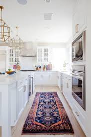 new traditional kitchen with bright gold and brass lanterns vintage navy blue and pink persian