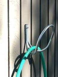 garden hose hanger with faucet