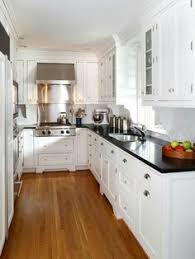 kitchen ideas white cabinets black countertop. Gorgeous Kitchen (SallyL: Ahmann LLC - Absolute Black Granite Countertops With White Cabinetry And Honey Coloured Flooring) Ideas Cabinets Countertop D