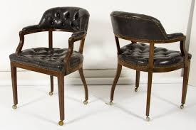 set of  tufted leather barrel back chairs  omero home