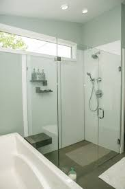 modern clear frameless glass shower wall system with high gloss acrylic walls