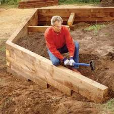 Small Picture Build a Wood Timber Retaining Wall DIY Outdoor Retreats