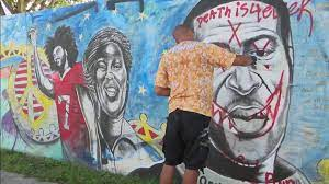 Artist repaints Miami George Floyd ...