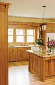 kitchens with light paint colors with oak cabinets and stainless steel appliances with gray wall and