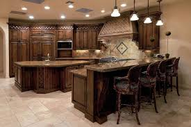 Traditional kitchen with dark wood cabinets and granite breakfast bar