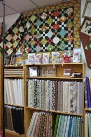 Quilt Lover's Hangout-Ft. Myers, FL - Peas In A Pod & Another display of fabrics and great shop samples. This shop was just full  of eye candy! Adamdwight.com