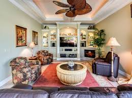 Tropical Living Room Design Tropical Living Room With Crown Molding By Adrian Waring Zillow