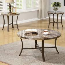 charming round grey granite top coffee table with black metal legs near two small lamp table on sandstone rug