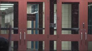 school doors. West Michigan School Administrators Say Closing Is A Complicated Process Doors