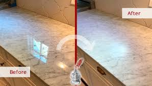 before and after picture of a white carrara marble countertop stone honing service in nashville
