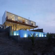 Longhi Architects designed the Beach House Q overlooking Misterio Beach,  Caete, Peru.