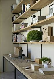 Office space with built in desk and shelving. Interior Designer: Marie  Laure Helmkampf.