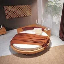 round bed furniture. This Unique Daring Round Bed Features A Low Profile, Solid Hardwood Frame  With Corner Back Unit Which Houses Symmetrical Nightstands On Either Side. Furniture