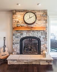 staggering fireplace with glass door cultured stone fireplace bedroom contemporary with bolster