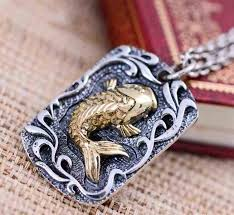 what do koi fish pendant leaping against the wave means