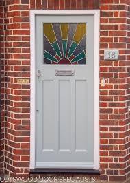 1920s front door with art deco sunrise