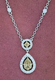 165 020 lady s white 18k necklace with 15 0 63 carat tw tapered baguettes g vs diamonds and 3 0 15 carat tw round g h vs2 diamonds 3550 00