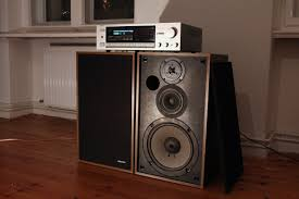vintage pioneer speakers. a vintage onkyo stereo receiver/amplifier. very analog and beautiful in silver. pioneer speakers