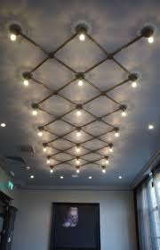 exposed ceiling lighting. The Gentle Glow From Exposed Lamps Creates Intricate Patterns On Wall, Generating A Sense Of Calm And Comfort. Ceiling Lighting T