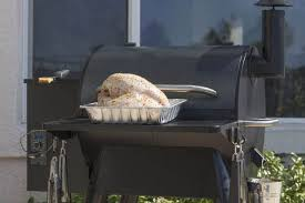 poultry sitting on the front table of a pellet smoker ready to be cooked