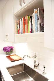 unique kitchen ideas for storing cookbooks glass shelves above sink