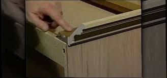 how to install crown molding on your cabinets construction repair wonderhowto