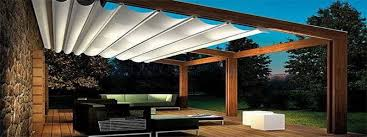 a modern pergola with top shades on sliders ...