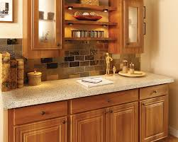 terra chiara thin granite countertop bronzite glass mosaic tile backsplash by granite transformations
