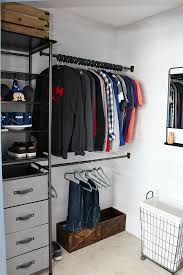 awesome closet organizer system with a mix of open shelving and closed drawer space for storage