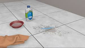 use a toothbrush or the edge of a sponge to clean the grout with the solution take care not to get the bleach solution on the tiles