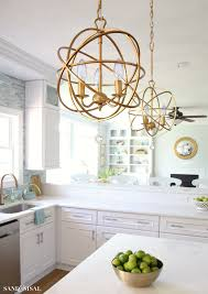 gold orb chandelier ballard designs sand and sisal