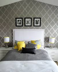 Idea: paint accent wall yellow and do this/similar stencil in dark grey.  Paint other walls lighter grey and find yellow accessories.