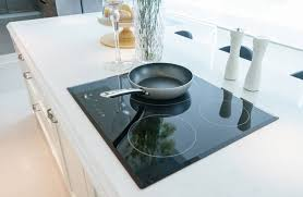 modern black smooth glass cooktop on white quartz counter modern black smooth glass cooktop on white quartz counter