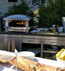 the gaucho provides the tradition of wood fire grilling but provides modern capabilities with a gas starter the kalamazoo outdoor