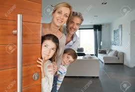 opening front door. Family Of Four Opening House Front Door Stock Photo - 74822154 N
