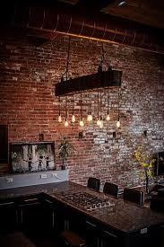 brick wall lighting. exposed duct pipes brick walls and lighting create a distinct modern industrial style in the kitchen decoist wall n