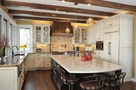 taj mahal granite kitchen terranean with gl front cabinets dark wood ceiling beams suelos de cocina